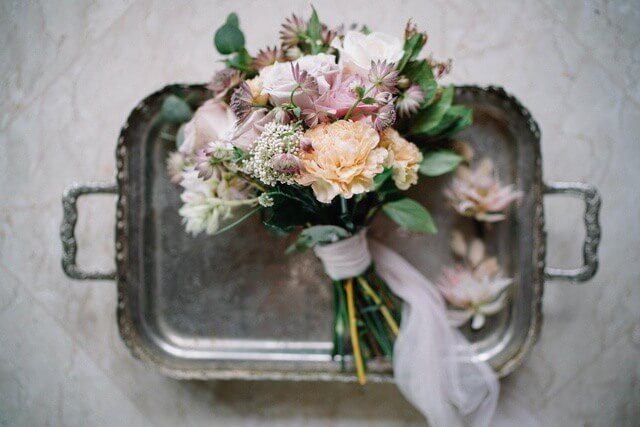 Bride's bouquet on rectangular silver tray