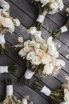 Several white rose bouquets