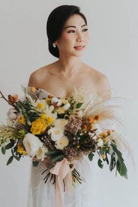 Bride holding very colourful bouquet