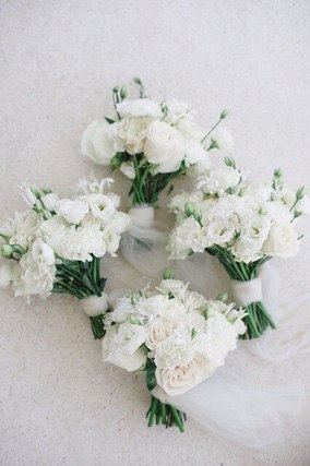 Four white hand bouquets