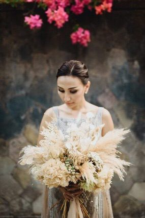 Bride holding dried flower bouquet
