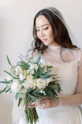 Bride holding a simple rose bouquet