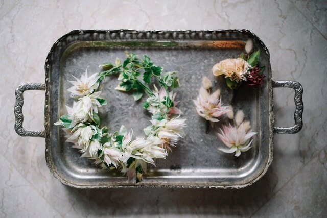 Flower crown and a trio of corsages on silver tray