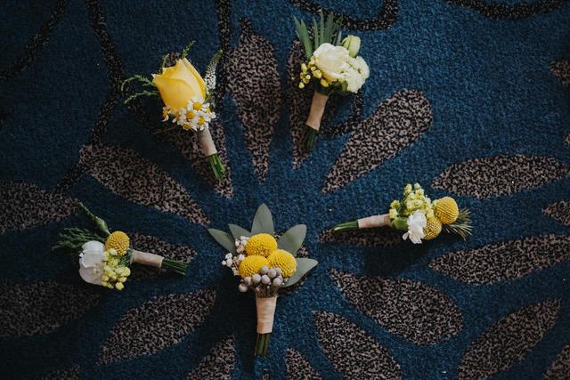 Five yellow boutonniere
