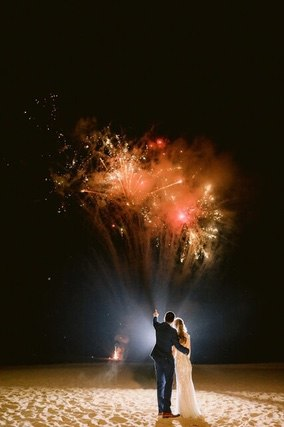 Bride and Groom watching exploding fireworks