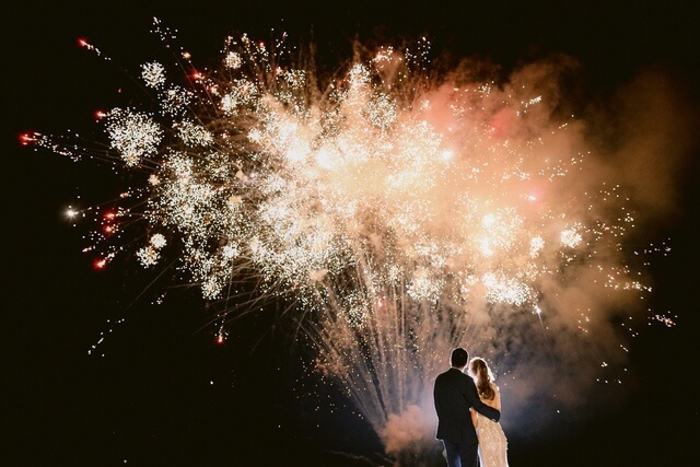 Bride and Groom watching fireworks display