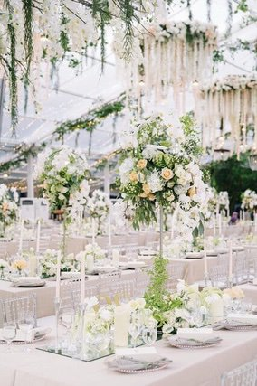 Large round chandeliers hanging above long tables