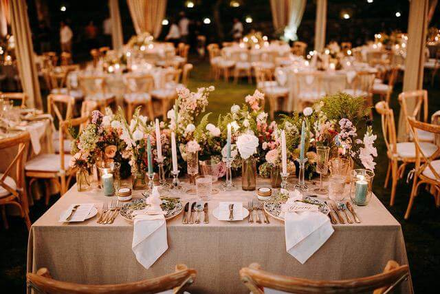 Bridal table with flowers, candles and various table adornments
