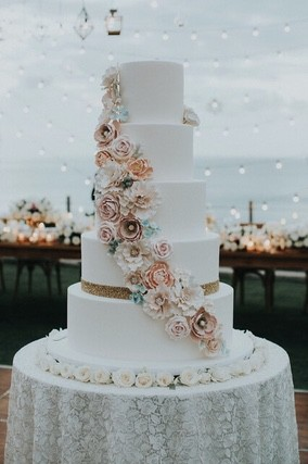 Wedding cake with flower accesories on round table