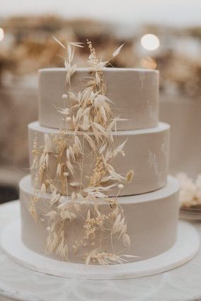 Three tiered cake adorned with dried flowers
