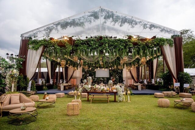 Marquee with lounge style set up in garden
