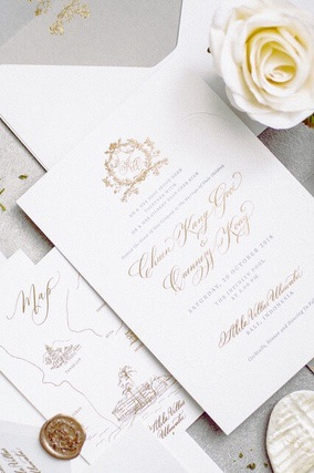 Wedding invitation and envelope with wax seal and a white rose
