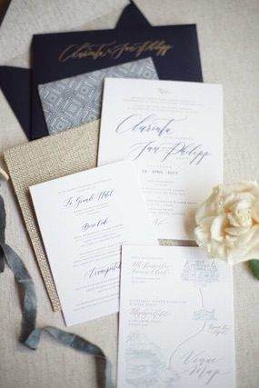 Wedding invitation and literature with white flower