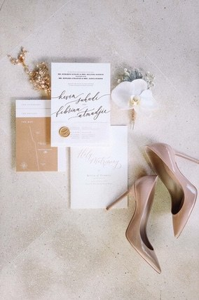 Wedding invitation with a white orchid and Bride's shoes