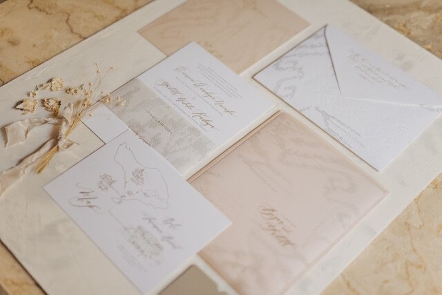 Creme coloured wedding invitation, envelope and literature