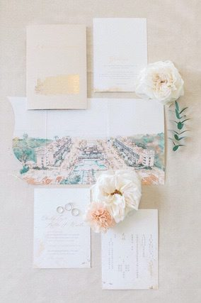 Wedding invitation with two pastel coloured flowers