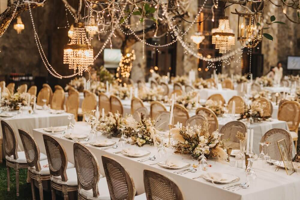 Wedding reception dining tables with gold colored decorations
