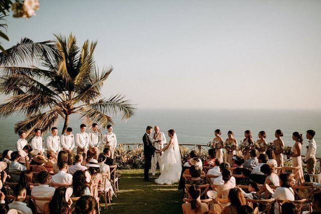 Bride and Groom and bridal party in a garden overllooking the ocean