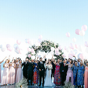 Wedding guests releasing pink balloons on the wedidng altar