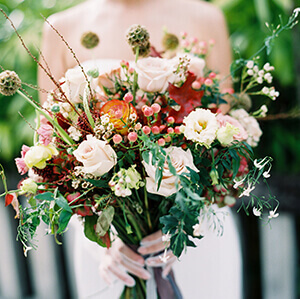 Bride's bouquet with autumnal coloured flowers