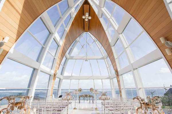 inside of bali wedding chapel with view of ocean