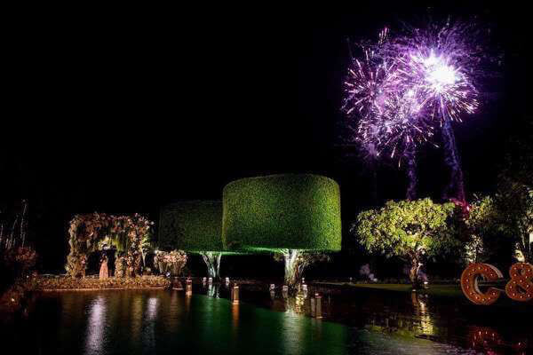 wedding reception at night with purple fireworks