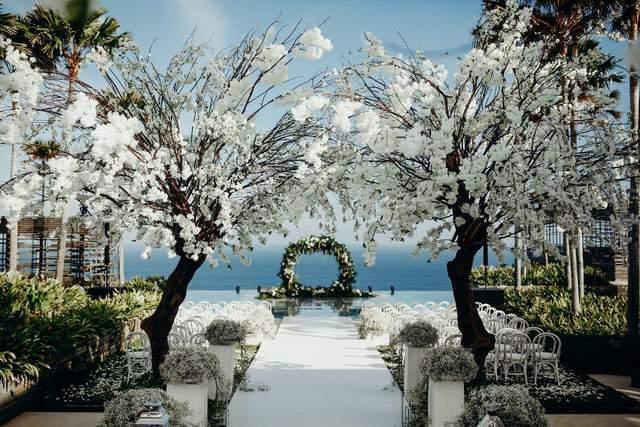 Round flowery wedding arch on floating wedding ceremony stage