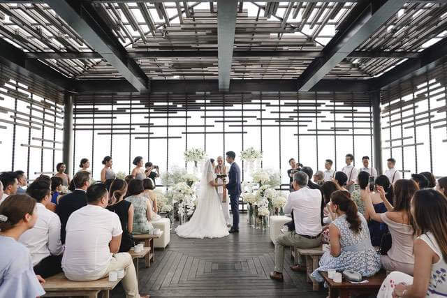 Inside Alila Villas Uluwatu's cliff edge cabana during wedding ceremony