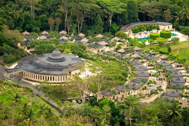 Aerial view of Amajiwo Resort including the main dining hall encircled by stone villas