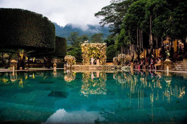 Extreme floral decoration on floating stage surrounded by large trees