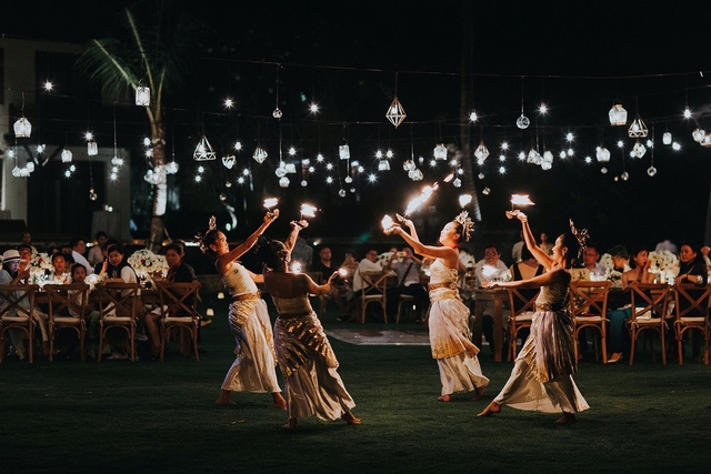 Balinese fire dancers performing in front of wedding guests