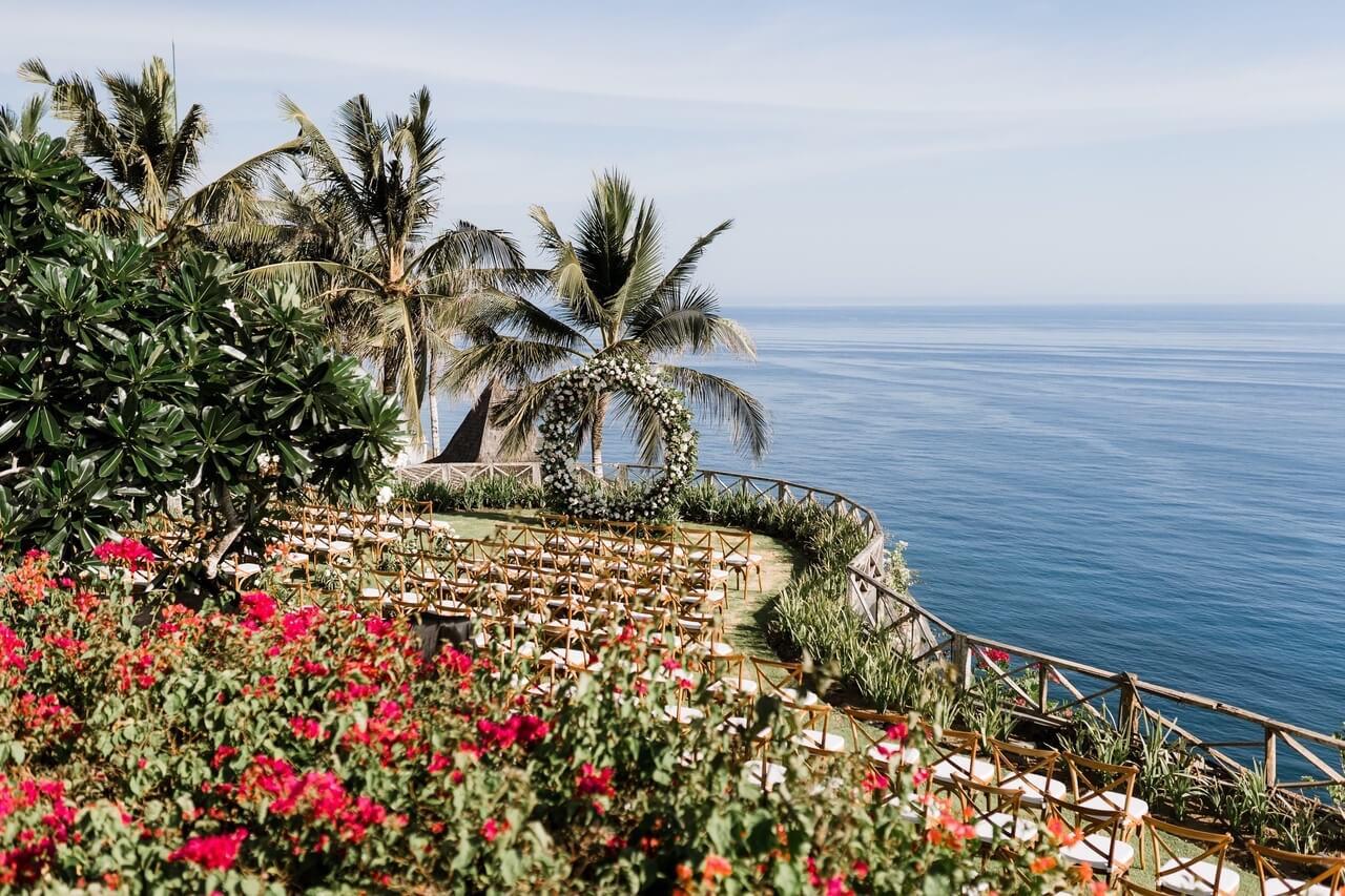 Bali garden with wedding ceremony set up overlooking ocean